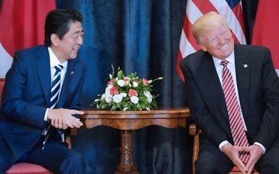 US President Donald Trump (R) takes part in a bilateral meeting with Japan's Prime Minister Shinzo Abe at the Villa Diodoro on the sidelines of the G7 on May 26, 2017 in Taormina, Sicily. (AFP Photo/Mandel Ngan)