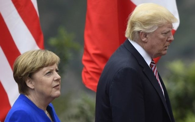 US President Donald Trump and German Chancellor Angela Merkel arrive for a photo during the G7 summit in Taormina, Sicily, on May 26, 2017. (AFP Photo/Miguel Medina)
