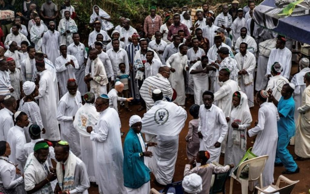 Supporters of the Indigenous People of Biafra (IPOB), members of the Yahveh Yashua Synagogue (Yisraelities Biafra Region) celebrate Shabbat outside the residence of the movement's leader Nnamdi Kanu in Umuahia, on May 27, 2017.  (AFP PHOTO / MARCO LONGARI)