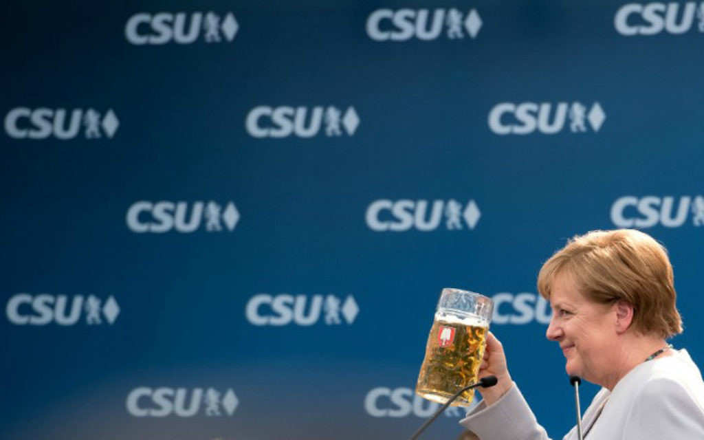 German Chancellor Angela Merkel takes a sip of beer after delivering a speech during a joint campaigning event of the Christian Democratic Union (CDU) and the Christian Social Union (CSU) in Munich, southern Germany, on May 27, 2017. (Sven Hoppe/dpa/AFP)