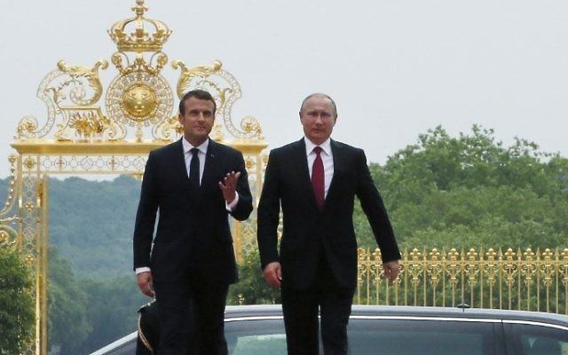 French President Emmanuel Macron (L) and his Russian counterpart Vladimir Putin arrive at the Palace of Versailles, near Paris, as they meet for talks on May 29, 2017. (AFP Photo/Pool/Francois Mori)