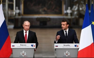 French President Emmanuel Macron (R) during a joint press conference with Russian President Vladimir Putin (L) following their meeting at the Versailles Palace, near Paris, on May 29, 2017. (AFP Photo/Christophe Archambault)