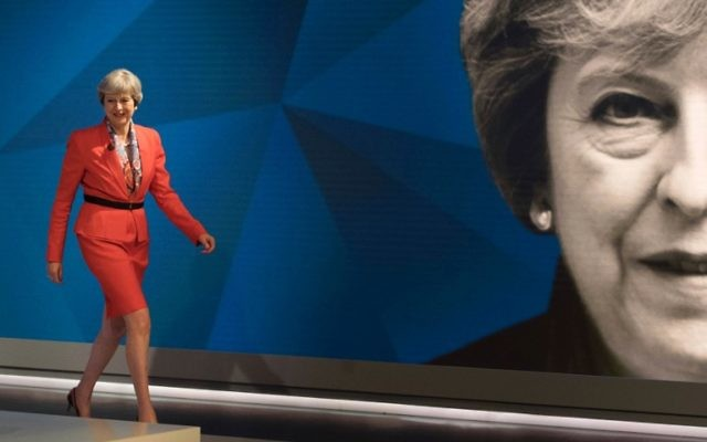 British Prime Minister Theresa May walks out to take part in the 'May v Corbyn Live: The Battle for Number 10,' Sky News and Channel 4 event in at Sky Studios in London, May 29, 2017. (AFP/POOL/Stefan ROUSSEAU)