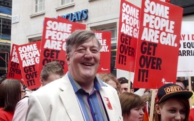Stephen Fry pictured at a 2012 Pride Parade in London (Photograph at WorldPride / Wikipedia)