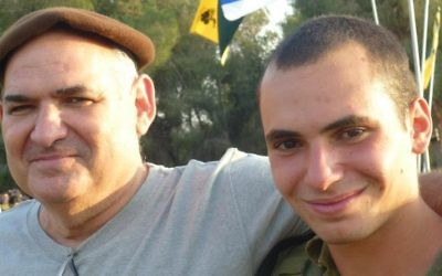 Avi Yacoby, left, poses for a photograph with his son Gilad, who later fell in the 2014 Gaza war. (Courtesy)