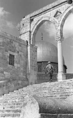 A paratrooper runs up the steps to the Temple Mount in Jerusalem's Old City on June 8, 1967. (Bamahane Magazine/Defense Ministry's IDF Archive)