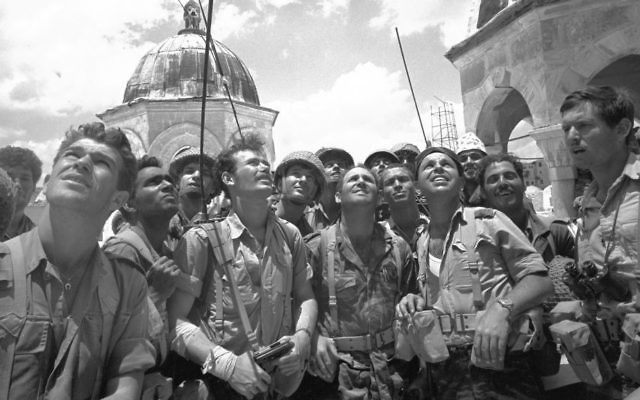 A group of paratroopers marvels at the Temple Mount on June 7, 1967, during the Six Day War. (Micha Bar-Am/ Defense Ministry's IDF Archive)