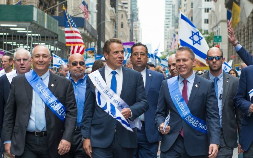 Strategic Affairs Minister Gilad Erdan, center-right, marches in the Celebrate Israel Parade on Sunday, June 4, 2017. New York Governor Andrew Cuomo, center, was an honorary grand marshal. (Alexi Rosenfeld)