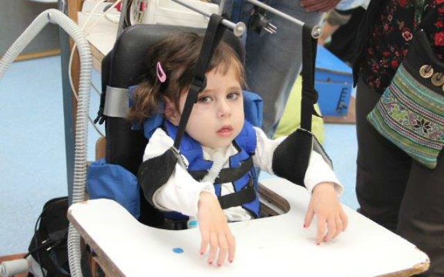 A child using ALYN's hand support development (Courtesy)