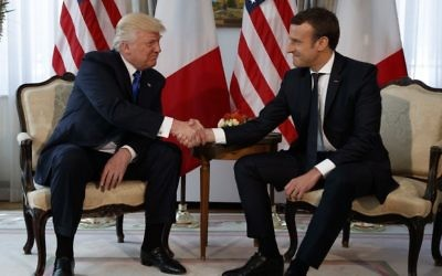 US President Donald Trump shakes hands with French President Emmanuel Macron during a meeting at the US Embassy, Thursday, May 25, 2017, in Brussels. (AP/Evan Vucci)