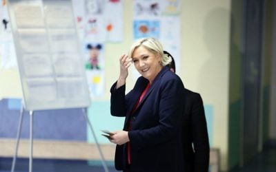 French far-right presidential candidate, Marine Le Pen smiles before casting her ballot in Henin Beaumont, France, May 7, 2017. (AP/Francois Mori)
