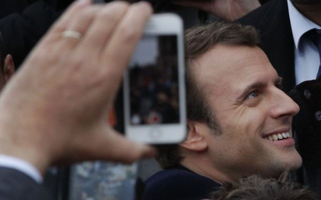 French independent centrist presidential candidate Emmanuel Macron shakes hands with well-wishers as he leaves the polling station after casting his ballot in the presidential runoff election in Le Touquet, France, Sunday, May 7, 2017. (AP/Christophe Ena)