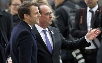 French President-elect Emmanuel Macron, left, and outgoing President Francois Hollande attend a ceremony to mark the end of World War II at the Arc de Triomphe in Paris, Monday, May 8, 2017. (Philippe Wojazer, Pool via AP)