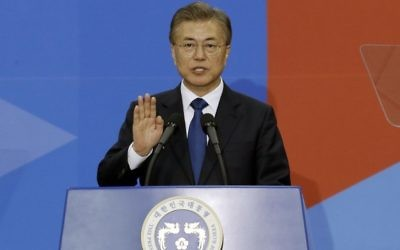 Newly elected South Korean President Moon Jae-in takes an oath during his inauguration ceremony at the National Assembly in Seoul, South Korea, Wednesday, May 10, 2017. (AP/Ahn Young-joon)