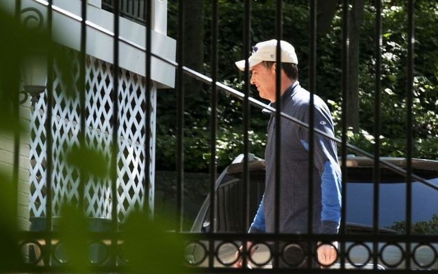 Former FBI Director James Comey walks at his home in McLean, Va., Wednesday, May 10, 2017. President Donald Trump fired Comey on Tuesday, ousting the nation's top law enforcement official in the midst of an investigation into whether Trump's campaign had ties to Russia's election meddling. (AP/Sait Serkan Gurbuz)