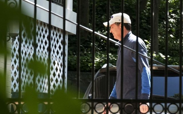 Former FBI director James Comey walks at his home in McLean, Virginia, Wednesday, May 10, 2017. (AP/Sait Serkan Gurbuz)