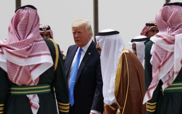 US President Donald Trump, center left, walks with Saudi King Salman, center right, during a welcome ceremony at the Royal Terminal of King Khalid International Airport, Saturday, May 20, 2017, in Riyadh. (AP Photo/Evan Vucci)