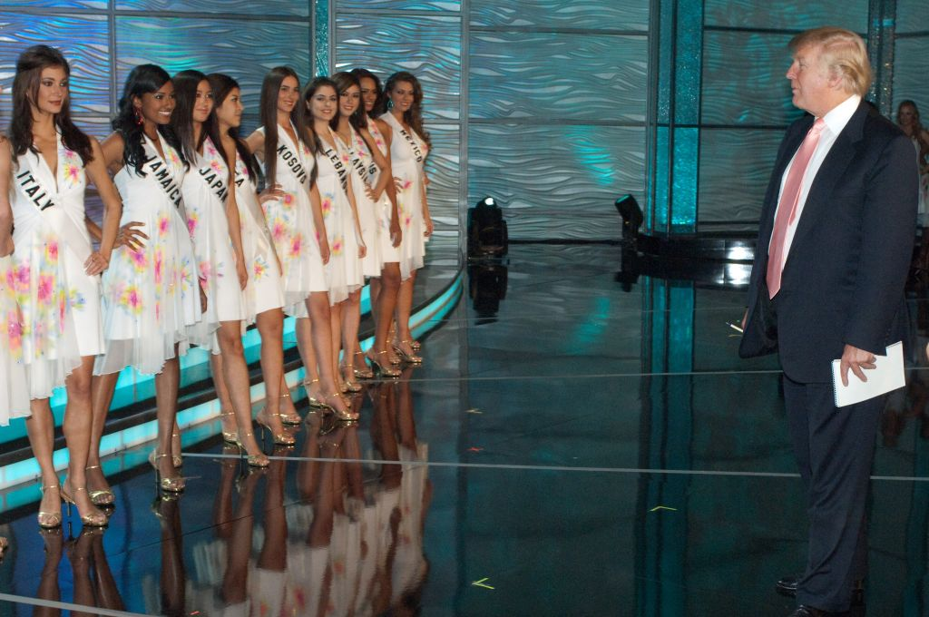 Miss Universe 2009 contestants take a break in rehearsals to meet Donald Trump in the Imperial Ballroom at Atlantis, Paradise Island, Bahamas on August 21, 2009. (HO/Miss Universe L.P., LLLP/ AP images)