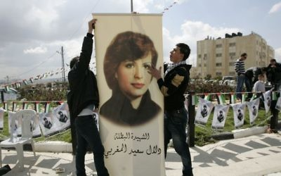 Palestinians inaugurate a square to commemorate Dalal Mughrabi, a Palestinian terrorist who killed dozens of Israeli civilians in a 1978 bus hijacking in Israel, seen in portrait, in the West Bank city of Ramallah, on  March 13, 2011. (AP Photo/Majdi Mohammed)