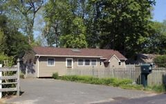 This May 18, 2017 photo shows one of 40 homes in a community run by the German American Settlement League in Yaphank, N.Y. The organization has settled a case with New York's attorney general, who claimed the GASL was not complying with state and federal fair housing laws because it had restricted ownership of homes to people of German descent. (AP Photo/Frank Eltman).
