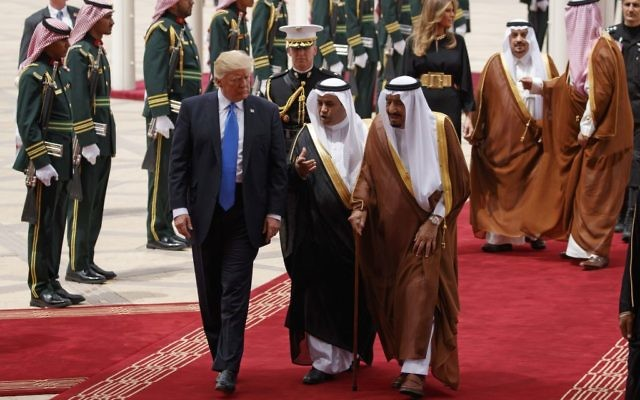 President Donald Trump walks with Saudi King Salman during a welcome ceremony at the Royal Terminal of King Khalid International Airport, on May 20, 2017, in Riyadh. (AP Photo/Evan Vucci)