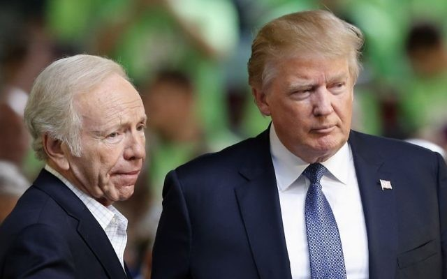Former Democratic vice presidential candidate, former Connecticut Sen. Joe Lieberman, a No Labels co-chairman, introduces Republican presidential candidate Donald Trump to speak at a No Labels Problem Solver convention, October 12, 2015, in Manchester, NH. (AP Photo/Jim Cole)