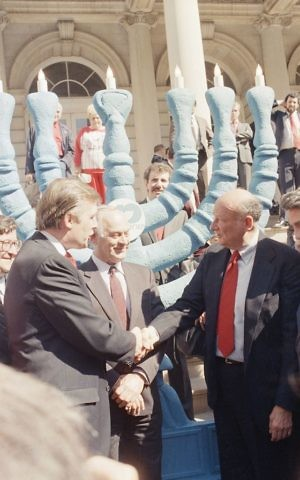 Donald Trump, left, and New York Mayor Edward I. Koch shake hands, Monday, Oct. 5, 1987 in New York in front of City Hall, during ceremonies marking Israel's 40th anniversary (AP Photo/Marty Lederhandler)