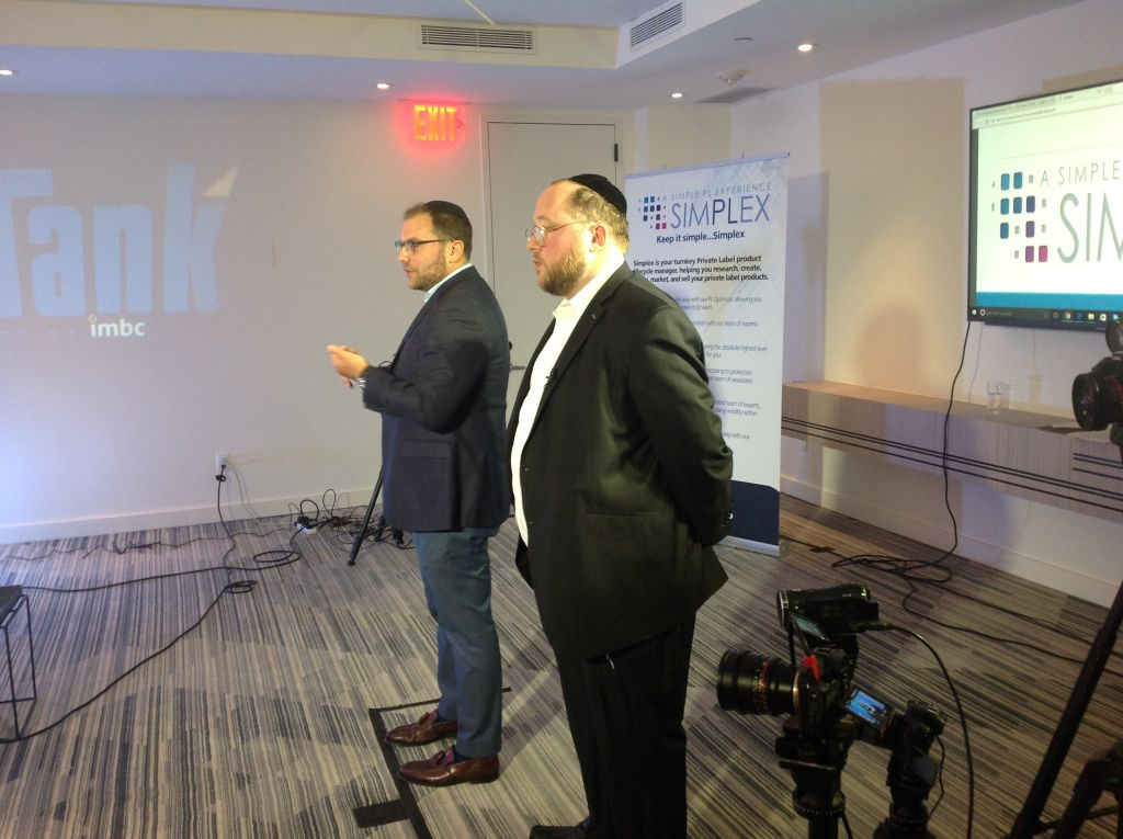 Eli Pasternak, front, and partner Shmuel Blumenfeld pitching a business that helps private retailers sell products on Amazon at The William Vale hotel in Brooklyn, May 22, 2017. (Ben Sales/JTA)