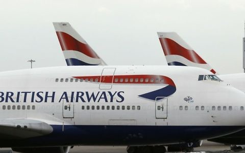 In this Tuesday, Jan. 10, 2017 file photo, British Airways planes are parked at Heathrow Airport during a cabin crew strike in London. (AP Photo/Frank Augstein)
