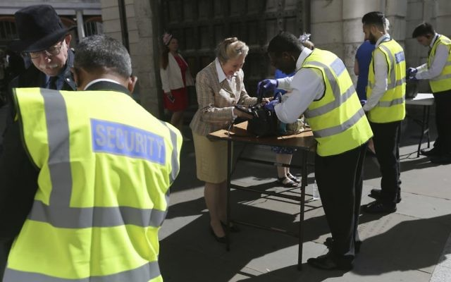 People have their bags searched outside St Paul's Cathedral in London, May 24, 2017 (AP/Tim Ireland)