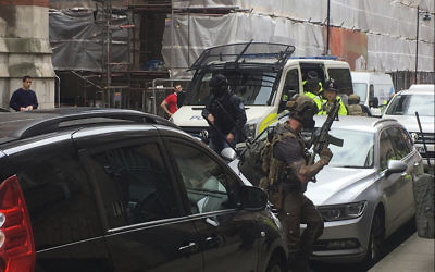 Police from the Tactical Aid Unit  prepare to enter Granby House apartments in Manchester England, Wednesday, May 24, 2017  in connection to Monday's Manchester explosion. (AP/Louise Bolotin)