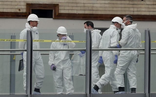 Forensic officers work near the Manchester Arena in Manchester, Wednesday, May 24, 2017. (AP/Kirsty Wigglesworth)