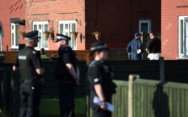 Police activity at an address in Elsmore Road, in connection with the concert blast at the Manchester Arena, in Manchester, England, May 24, 2017. (Joe Giddens/PA via AP)