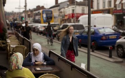 Two women sit in a bar in Curry Street in Manchester, Britain,May 24, 2017. (AP Photo/Emilio Morenatti)