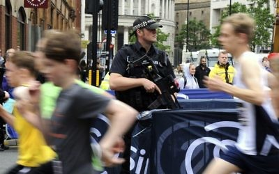 Armed police on guard during the Great Manchester Run in Manchester, England, May 28, 2017. (AP/Rui Vieira)