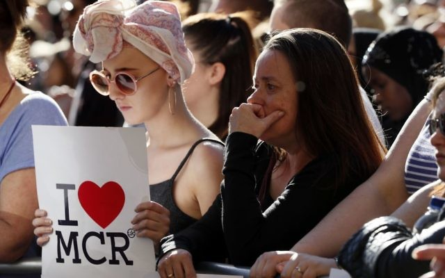 People attend a vigil in Albert Square, Manchester, England, May 23, 2017, the day after the suicide attack at an Ariana Grande concert that left 22 people dead. (AP Photo/Kirsty Wigglesworth)