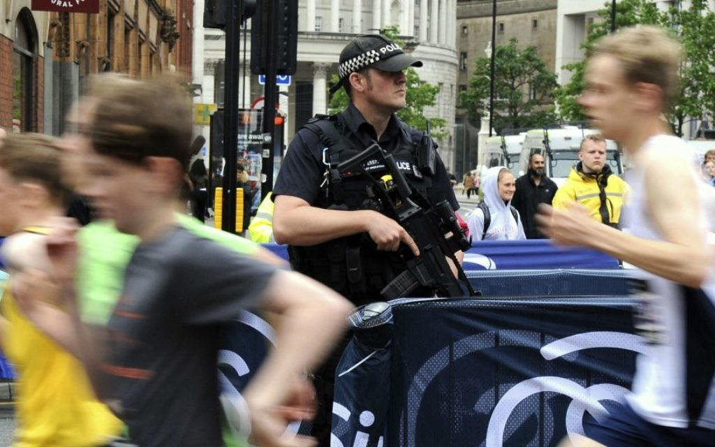Armed police guard the Great Manchester Run in Manchester, England Sunday, May 28, 2017. (AP Photo/Rui Vieira)