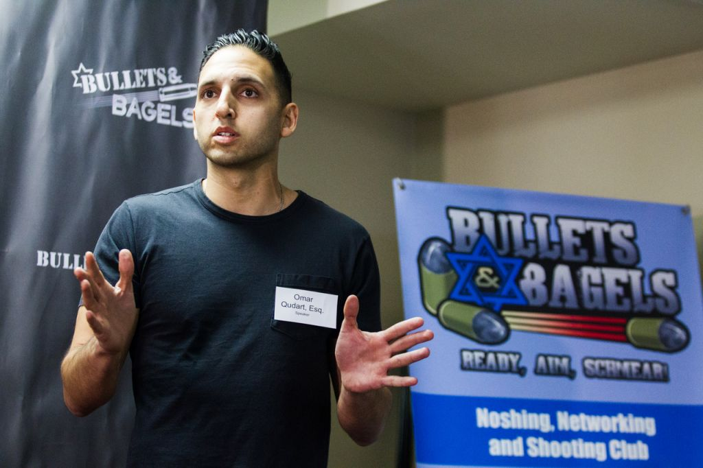 Attorney Omar Qudrat (the name tag worn contains a typographical error) speaks at a recent Bullets & Bagels event. (Courtesy B&B)
