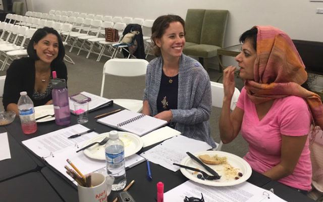 Tiffany Mualem, Ayelette Robinson and Aneela Qureshi discuss script changes during a  rehearsal break for 'More Courage.' (Courtesy JWT)