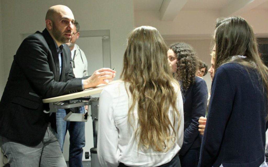 Ahmad Mansour addresses students after a lecture at Campus Muengersdorf University. (Franziska Richter)