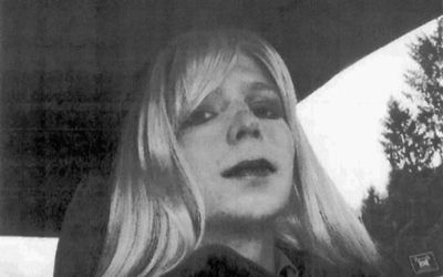 In this undated photo provided by the US Army, Pfc. Chelsea Manning poses for a photo wearing a wig and lipstick. (US Army via AP)