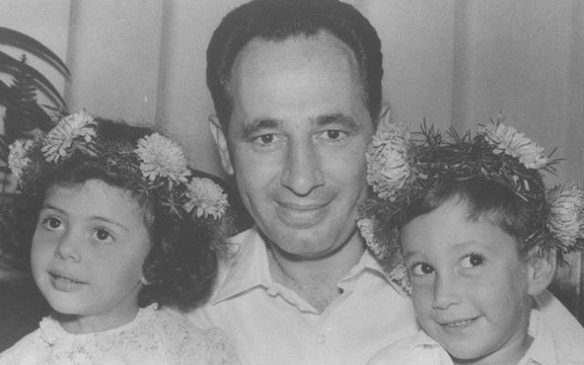Shimon Peres, center, and Chemi Peres, right, celebrating Chemi's birthday in 1962 (Courtesy: GPO)