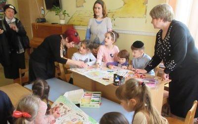 Children at Tikva's kindergarten preparing materials for the Jewish festival of Lag B'Omer,  Odessa, Ukraine, May 12, 2017. (Photo Sue Surkes)