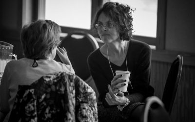 Two mothers speaking at an Eshel retreat. (Courtesy)