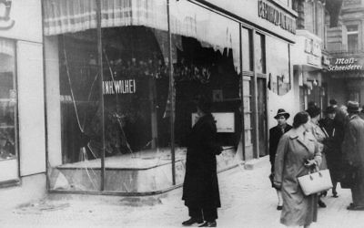 A man looks at the wreckage of a Jewish shop in Berlin on November 10, 1938, in the aftermath of Kristallnacht, an organized nationwide attack carried out by Nazi paramilitary forces and German civilians over two days. (AP Photo)