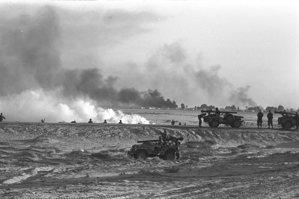 Smoke rising from targets hit by Israeli artillery at the Suez Canal during the Six Day War. (Han Micha/Government Press Office)