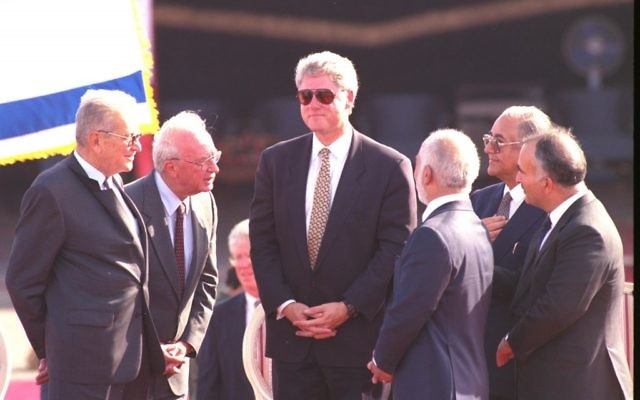 US President Bill Clinton, with sun glasses, together with President Ezer Weizman, Prime Minister Yitzchak Rabin, and Jordan's King Hussein after the Israeli-Jordanian peace treaty was signed in the Arava desert, October 1994 (Avi Ohayon/GPO)