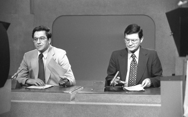 The 'Mabat' news program, with two of its anchors, Daniel Peer (R) and Yaacov Achimeir (L) in 1980. (Herman Chanania/GPO photo archive)