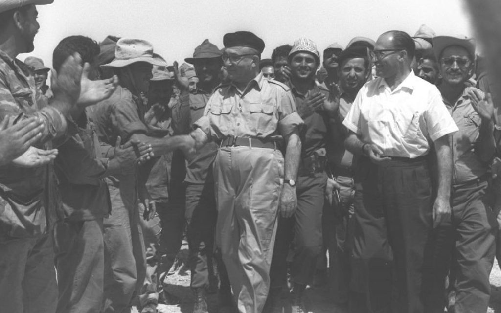 Then-prime minister Levi Eshkol, center, and future prime minister Menach Begin, right, greet troops in the Sinai Peninsula following the Six Day War on June 13, 1967. (GPO)