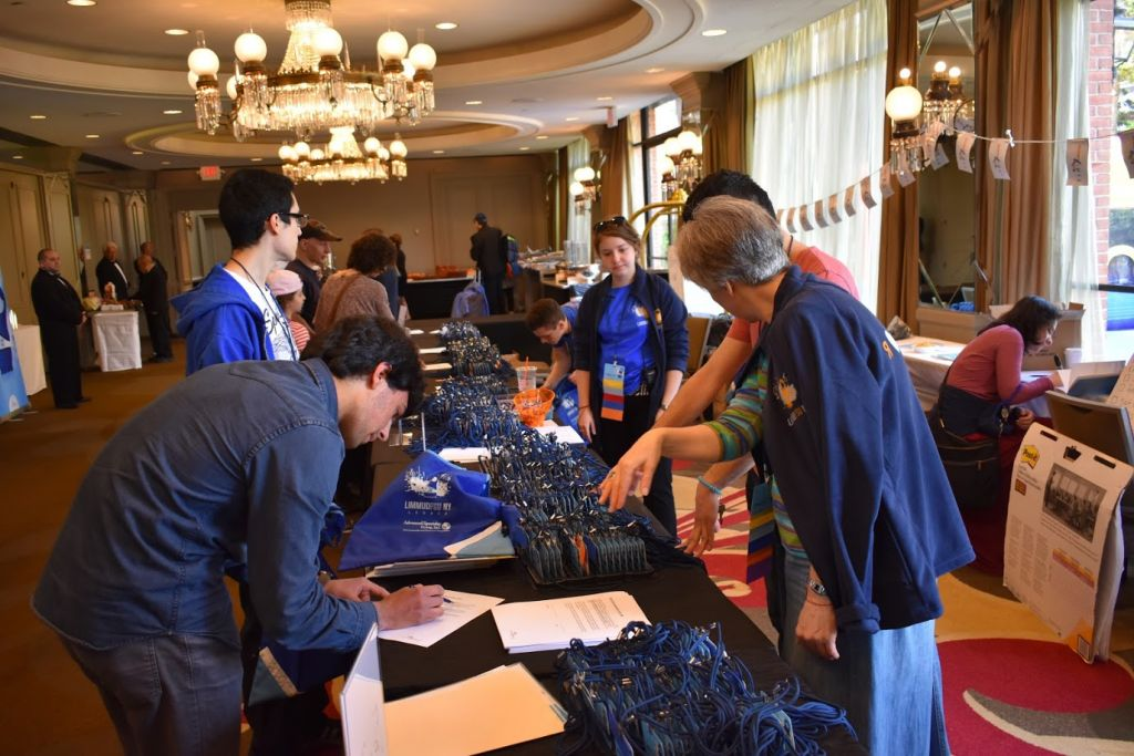 Guests register at the Hilton in Westchester, New York for the Limmud FSU program, which ran from May 14-16, 2017. (Limmud FSU)